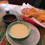 Lupida's Mexican cheese dip with chips.